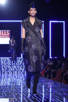 A model walks the ramp showcasing designer Namrata Joshipura's collection during the grand finale of Wills lifestyle India Fashion Week, Aut...