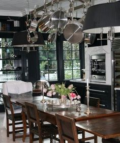 Windsor Smith's midnight blue kitchen. It's casual and relaxed- very Parisian bistro.  The cabinets are painted Benjamin Moore's Polo Blue.  Seriously, this is one of my all-time favorite kitchens!