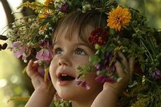 Cute Little Girl in The Flowers