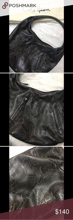 Cole Haan Snakeskin Hobo Bag Excellent used condition. Comes with dust bag.  Two zip up front pockets. One zip up pocket on the inside and two extra pockets. Beautiful stitching on the handle.  NO TRADES 🙅🏻 ALL REASONABLE OFFERS ARE ACCEPTED 😊👍🏽 NO LOWBALLERS!!! 😒✌🏽️✌🏽 LET'S BUNDLE!!!! 🎋🎉🎁🎊🎈  🌹(36) Cole Haan Bags Hobos