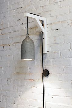 Lighting fixtures can be pricey but it's also to make your own out of concrete, like this concrete pendant lamp. For step-by-step instructions, check out our website.