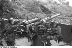 German paratroopers manning a 7.5 cm Flak 264/3(i) anti-aircraft gun, San Felice Circeo, Italy, 26 Dec 1943; Photographer : Toni Schneiders; Source: Bundesarchiv; Identification Code: Bild 101I-567-1503E-19