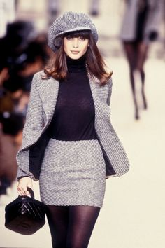 This 1994 Chanel women's suit shows the trends of the 90's with the black tights, matching skirt and jacket and high collared top. Laura Biagiotti created a very similar piece in her 2018 collection. The suit has a tight fighting pencil skirt, matching jacket, tights, a high collared shirt, and even a hat to go with it. - Hannah 4/20/18