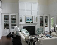 Bookshelves and fireplace in the hamptons