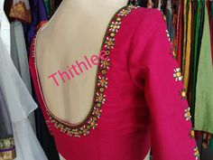 Beautiful pink color designer blouse with simple floral design hand embroidery mirror and thread work on back neckline and sleeves. Best Blouse Designs, Simple Blouse Designs, Saree Blouse Neck Designs, Stylish Blouse Design, Bridal Blouse Designs, Blouse Patterns, Mirror Work Blouse Design, Neckline, Mirror Work Saree