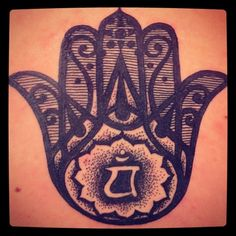 My tattoo was done by Matt Decker at Premium Tattoos in Oakland, California. Its the hand of hamsa but instead of the eye at the base of the hand I asked for the chakra symbol for the heart. Its in the middle of my upper back. The pain was nearly unbearable for me but it was completely worth it because I think it is so beautiful. I've been wanting this tattoo for about two years now and I am completely satisfied. Could not have asked for better work.