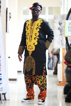 I love the way he mixed the dashiki with sneakers.