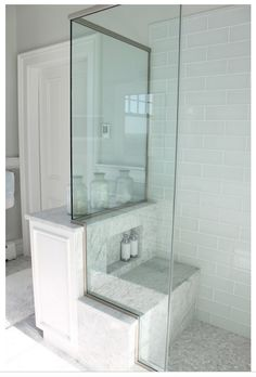 Molly Frey Design: Cottage bathroom with blue glass shower tile shower surround with carrara marble shower. Inset storage on shower bench. Glass Tile Shower, Blue Glass Tile, Glass Tiles, Half Glass Shower Wall, Bad Inspiration, Bathroom Inspiration, Garden Inspiration, Master Shower, Master Bathroom