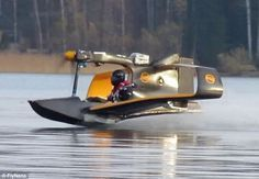 Ready for take off: The FlyNano tears across Lake Hepari, in Kirkkonummi, Finland, ready for its maiden flight earlier this month