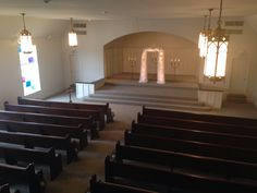 A look at our newly renovated chapel. The dark stain on the pews really adds to the romantic ambiance.