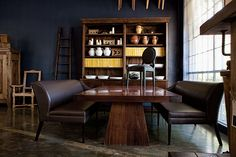 The Pierre Cronje showroom in Wynberg, Cape Town - Wolfe st, Chelsea Village. (An Artois bookcase behind a Sygnia II dining table) Fine Furniture, Cape Town, Showroom, Chelsea, Bookcase, Dining Table, Flooring, Home Decor, Decoration Home