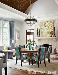 Dining chairs upholstered in a striped fabric of turquoise, deep blue, brown, and cream set the palette for the rest of the home. - Photo: Emily Jenkins Followill / Design: Tish Mills