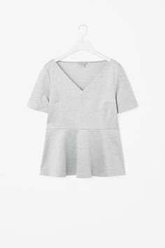 This wide v-neck top has a high-waist seam with a circle cut skirt panel. Made from soft cotton with a melange finish, it has neat short sleeves and a hidden side zip for a close fit.