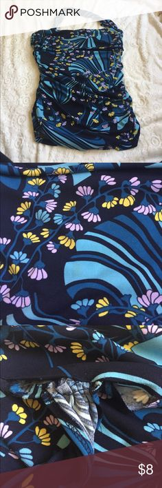 BCBG halter top This is a great top for summer.  It is a halter style with a raunching detail down the side and a chunky halter.  The strap and the hem around it is coming undone and could but it is a quick sewing project that shouldn't be to difficult but you can still wear it without it or turn it into a tube top due to the stretchiness of the shirt.  Pet friendly home. BCBG Tops