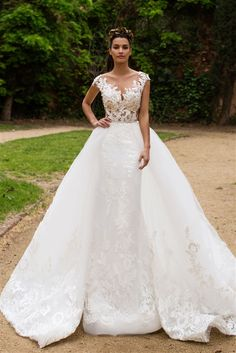 2017 Wedding Dress   CONVERTIBLE WEDDING DRESS! TWO LOOKS IN ONE WITH A DETACHABLE SKIRT. Enrika 2017 White Collection is a Modern and Romantic Lace, Tulle, and Satin Fit and Flare Mermaid Gown with an Illusion Lace Bateau Neckline Over Dipped Sweetheart Interior, Illusion Tank Straps, Lace Fitted and Boned Bodice Past Hips, Lace Applique on Tulle Layered Fit and Flare Mermaid Skirt, Chapel Train, Illusion Lace Back Over Low Back Interior.