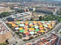 An Urban Parasol Forest--in Cordova, Spain--a public place designed for citizens to sit under for shade or sit upon for sun
