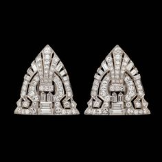 Pair of Diamond White Gold Clip Brooches | From a unique collection of vintage brooches at https://www.1stdibs.com/jewelry/brooches/brooches/