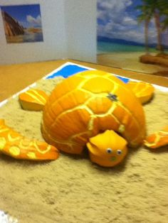 Fall pumpkin idea it's a turtle the sand is brown sugar just to let you know 1. Cut your pumpkin in half. 2. Cut to curve arms and shorter two back legs 3. Have a gourd with all our angle bottom for head 4. Carve curves lines to add the print. Lay any sea shells if you want or anything!
