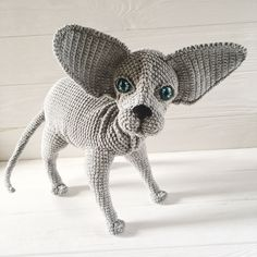 Amigurumi sphynx cat has all poseable paws and big ears.