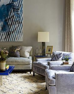 graphic wall art, and crushed velvet chairs.  so many textures.  Steven Gambrel.