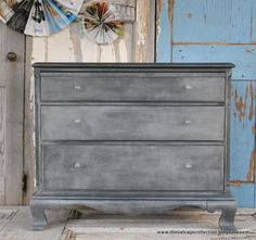 Faux zinc finish with Graphite Chalk Paint® decorative paint by Annie Sloan (and a surprise) on dresser. Via Amy of the Salvage Collection.