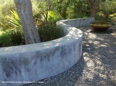 Curved concrete wall/seating