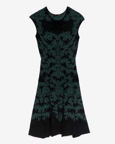 """intermix: A fit & flare silhouette exudes a romantic flair due to the jacquard knit. Crew neck. Sleeveless. Unlined. In black/emerald.  Fabric: 50% rayon/32% viscose/18% nylon  Length from shoulder to hem: 34"""" for size small  Made in USA."""