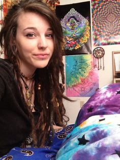 vertical labret, double nostril, septum and dreads..this chick is badass