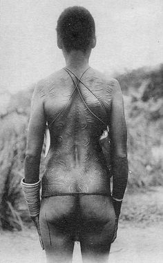 Africa | Yaelima woman with scarification. DR Congo | Scanned old postcard; Thill Nels love the concentric circles