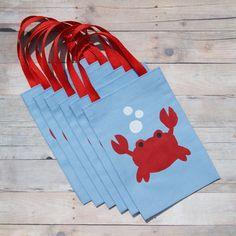 He encontrado este interesante anuncio de Etsy en https://www.etsy.com/es/listing/102766527/crab-favor-bags-set-of-6-under-the-sea