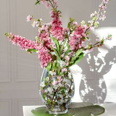Artificial stock flowers & cherry blossoms are such a beautiful combination. Wonderful hues of pink. Stock Flower, Artificial Silk Flowers, Flowers Online, Cherry Blossoms, Glass Vase, Tropical, Traditional, Pink, Beautiful