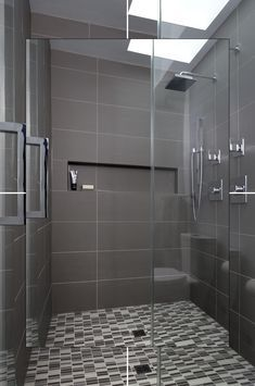 Many factors come into play in choosing the perfect shower tile, and often the shower's design will dictate the type of tile that can or should be used. For example, if you love a curved shower bench, you will need to use a smaller tile. Bathroom Sets, Small Bathroom, Master Bathroom, Navy Bathroom, Brown Bathroom, Basement Bathroom, Washroom, Modern Bathroom Design, Bathroom Interior Design