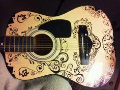 My guitar designs. Sharpie art on a cheap melody guitar.