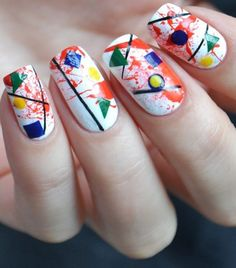 The Multi- Geometric Nails. Multi-geometric nails are next on our list because of their classy appearance and amazing play of colors.