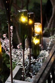 Green Glass Bottles Reborn as Gorgeous Torches backyard outdoor lighting ideas for your best living space Green Glass Bottles, Lighted Wine Bottles, Bottle Lights, Bottle Lamps, Garden Art, Garden Design, Landscape Design, Herb Garden, Aesthetic Header