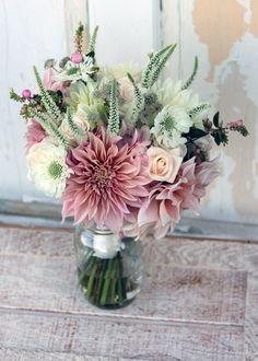 Brides Bouquet.  Cafe Au lait dahlias with garden flowers and roses. Roses from Apko Growers.