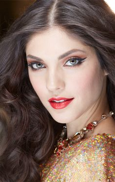 Dazzle with a smoldering eye and a perfect red lip, featured in The Golden Glamour Look by Mary Kay.