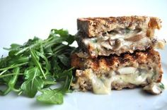 White Truffle Grilled Cheese - Creamy melted Fontina and Parmesan cheese + crunchy whole grain bread + woody mushroom flesh + white truffle essence = snowy day indulgent perfection. http://food52.com/recipes/8513-white-truffle-grilled-cheese