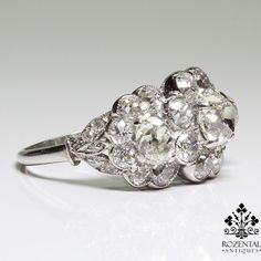 Period: Edwardian (1901-1920) Composition: Platinum Stones: - 1 cushion Old mine cut diamond of I-VS2 that weighs 1ctw. - 2 cushion Old mine cut diamonds of H-VS2/SI1 that weigh 1.20ctw. (0.60ctw. eac