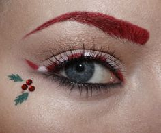 Cute in it's simplicity - Red crystal holly berries with candy cane eye liner and a red brow make up this Christmas inspired eye makeup.