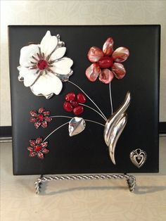 Jewelry art on a ceramic tile. The crafty artisan Judith Cary.