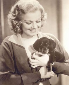 Jean Harlow with her dachshund named Nosey. At the time of her untimely death from kidney disease at the age of she was engaged to William Powell. It was Powell who then took over the care of Harlow's aging dachshund. Vintage Dachshund, Dachshund Love, Vintage Dog, Daschund, Funny Dachshund, Carole King, Jean Harlow, Donna Reed, Classic Hollywood