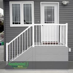 Simple maintenance-free steps for a side door entry.  Classic gray decking and fascia with white aluminum railing.