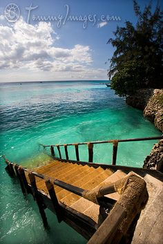 Nungwi, Tanzania - Stairs and rock walls line the coast of northern Zanzibar.
