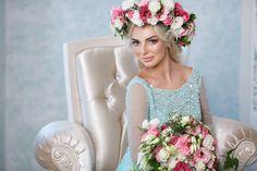 beautiful bride in flowers wreath