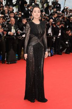Gong Li in Cannes. I like it but wish it was sleeveless/strapless/plunging V/something. via @The Cut