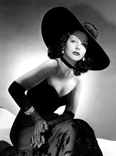Hedy Lamarr (an Austro-American actress and inventor) wearing an evening dress with a cartweel hat, long gloves and neckband - i pinned this pic because her professions are very impressive i mean who can be an actress and an inventor at the same time (;A;) so awesome