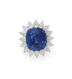 AN IMPRESSIVE SAPPHIRE AND DIAMOND RING, BY CARTIER