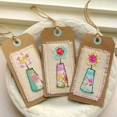 I know they are supposed to be gift tags but they would make cute book markers. I could use these to mark places in quilt books and magazines. Fabric Cards, Fabric Gifts, Free Motion Embroidery, Machine Embroidery, Card Tags, Gift Tags, Sewing Crafts, Sewing Projects, Book Markers