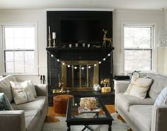 i love this look! we did the same thing in our home, and it made such a difference- the tv just fades into the background unless it's on! :)...